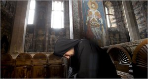 a-monk-prays-in-the-decani-orthodox-monastery